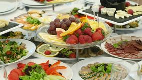 Food served on the table , the Swedish table: meat, rice, pasta, salads and various cakes and pastries.  stock footage