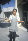 A food server carrying cherry pies royalty free stock photo