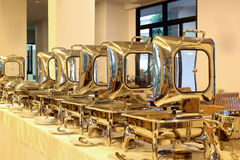 Food service steam pans on buffet table Royalty Free Stock Image