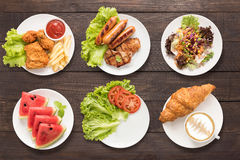 Food set fried chicken and chips, bbq meat and sausage, salad, w Royalty Free Stock Image