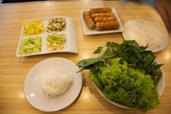 Food set vietnamese meatball wraps nam neung or Nam Neaung thai style server with fruits and vegetables in local restaurant. At Udonthani city in Udon Thani stock photo