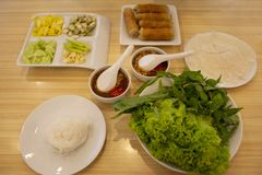 Food set vietnamese meatball wraps nam neung or Nam Neaung thai style server with fruits and vegetables in local restaurant. At Udonthani city in Udon Thani royalty free stock photography