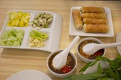 Food set vietnamese meatball wraps nam neung or Nam Neaung thai style server with fruits and vegetables in local restaurant stock photos
