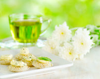 Several canapes and cup of herbal tea Stock Image