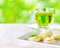 Several canapes and cup of herbal tea Stock Photo