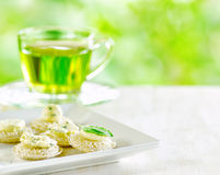 Several canapes and cup of herbal tea Stock Photography