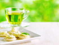 Several canapes and cup of herbal tea Stock Photos