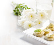 Several canapes and glass of milk Stock Images