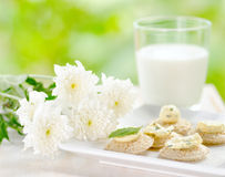 Several canapes and glass of milk Royalty Free Stock Photos