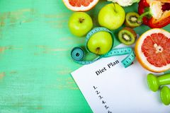 Food and sheet of paper with a diet plan Royalty Free Stock Images