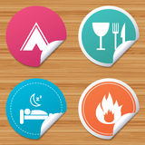 Food, sleep, camping tent and fire signs. Round stickers or website banners. Food, sleep, camping tent and fire icons. Knife, fork and wineglass. Hotel or bed Royalty Free Stock Photos