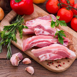 Food. Sliced pieces of raw meat for barbecue. On wooden surface. Meat raw steak. Beef steak bbq. Spices for cooking meat Stock Images