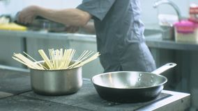 Cook in the kitchen of the restaurant prepares pasta carbonara stock video footage