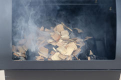Food Smoker. BBQ and food smoker in use stock photos