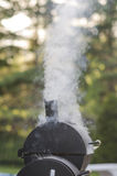 Food Smoker. BBQ and food smoker in use royalty free stock image
