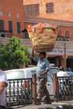Food and snack Hawker. A man carries fried traditional pancake snacks to sell in streets of Jaipur, India Royalty Free Stock Photos
