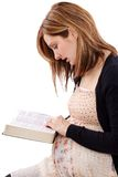 Food for the soul. Young christian lady reading Bible for feeding her soul Royalty Free Stock Image