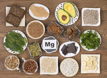 Food sources of magnesium. Such as pumpkin seeds, poppy seed, beans, chocolate, almonds, sunflower seeds, oatmeal, buckwheat, hazelnuts, sesame bars, figs Royalty Free Stock Photography