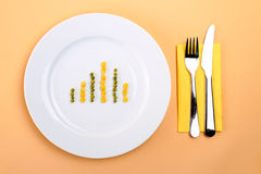 Food speculation. Green peas and yellow corn as diagram - food speculation Stock Image