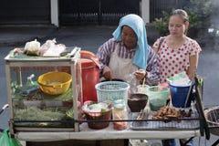 Food Stall in Bangkok. Thailand, Bangkok, Thai woman cooking at a food stall in Bangkok Stock Image