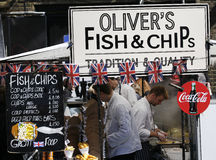 Food Stall in Camden Market. London, UK - April 20, 2013: A food stall, fish and chips, people present, in Camden Town, also called Camden Lock. The Market is Royalty Free Stock Images
