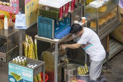 Food stall in Hong Kong selling drinks and street food royalty free stock photo