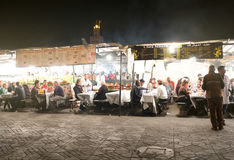 Food stalls in Marrakesh night market. View of the popular food stalls that appear in the famous Djeema El Fna in Marrakech after dusk. Locals and tourists royalty free stock photos