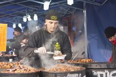 Food stand at the festival of funeral the winter Stock Image