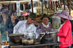 Food stand in the local market in Villa de Leyva, Colombia. July 15, 2017 Villa de Leyva, Colombia: people at a food stand at the weekly Saturday market in the royalty free stock images
