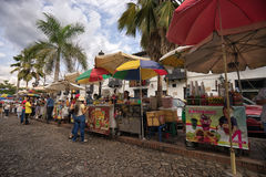 Food stands in Giron Colombia. July 23, 2017 Giron, Santander: food stands lining the cobblestone colonial street in the historic town centre on Sundays Royalty Free Stock Images