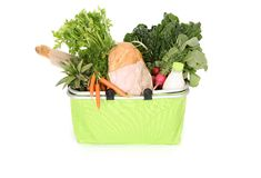 Food staples in shopping bag Stock Photo