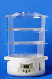 Food Steamer. Multi-Tier Food Steamer isolated on blue background Royalty Free Stock Photo