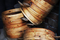 Food steamers. There are some old bamboo food steamers in the corner of the wall Stock Photography