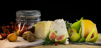 Food still life with berry,figs,walnut,cheese and spice Royalty Free Stock Images