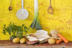 Food still life, bio food. Food still life: vegetables for the soup + vintage kitchen utensils, + a vintage cook book, slow food, bio food Royalty Free Stock Photography