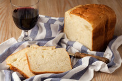 Food. Still life. A glass of wine, loaf of bread Stock Photos