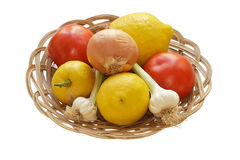 Food Still Life. Lemons, Tomatoes, Garlic Bulbs and an Onion on a Bowl, Isolated on White Background Stock Images