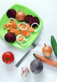 Food stillife. Free composition of the food ingredients. Choped carrots, tomato, cucmber, onion stock photo