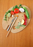 Food stillife. Free composition of the food ingredients. Choped carrots, tomato, cucmber, onion royalty free stock image