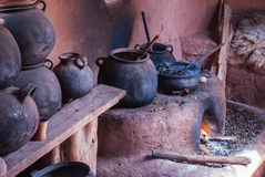 Food is on the stove and cookin. Old Kitchen of ancient Peru Royalty Free Stock Photos