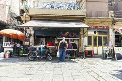 Food street market in Palermo in Sicily, Italy. Palermo, Italy - August 10, 2017: Food street market called Ballaro with sellers closing their store in the old Stock Image