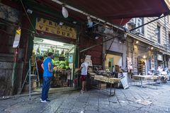 Food street market in Palermo in Sicily, Italy. Palermo, Italy - August 10, 2017: Food street market called Ballaro with sellers closing their store in the old Stock Photo