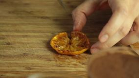 Food styling for chocolate mousse with orange jelly dessert. On table in the kitchen closeup stock footage
