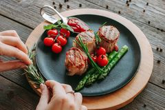 Food styling restaurant meal serving grilled meat. Food styling and restaurant meal serving. Grilled tenderloin medallions with vegetables royalty free stock photo