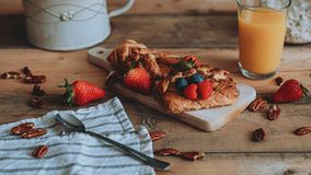 Food styling sweet pastry with fruit on the wooden planks stock image
