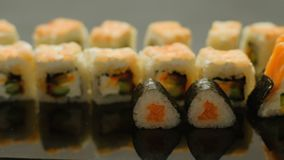 Food stylist japanese cuisine hand put sushi rolls. Food stylist. japanese cuisine. hand put sushi rolls in a row stock footage