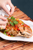 Food Stylist Plating Fish Royalty Free Stock Photography