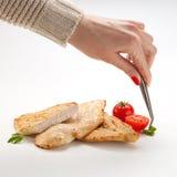 Food stylist prepares chicken stock image