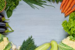Food summer background with copy space for text. Fresh organic vegetables: carrots, zucchini, eggplants, garlic, basil. Raw ingredients for veggie salad Royalty Free Stock Photography