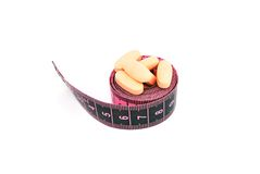 Food supplements and a measure tape Stock Image